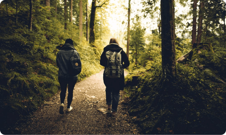 Young man and women walking in the forest