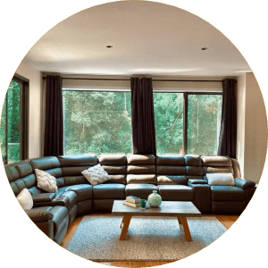Interior view of Hills & ranges private sitting area with huge sofa set